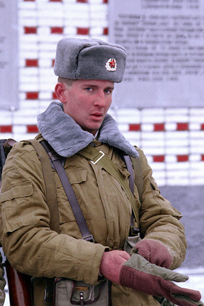 68dad02c96e Soviet army soldier wearing ushanka. Formal and closed setup of Ushanka  worn with the Winter version of the